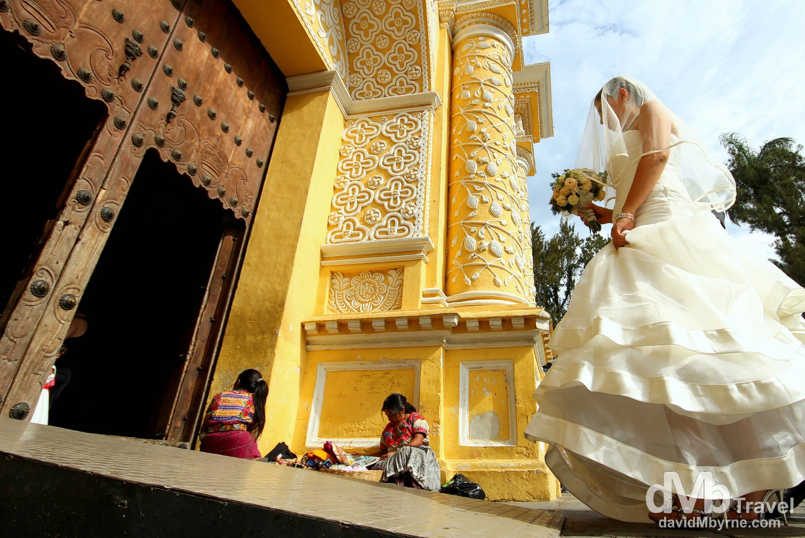 A bride entering the Iglesia y Convento de Nuestra Senora de la Merced, Antigua, Guatemala. May 25th 2013.