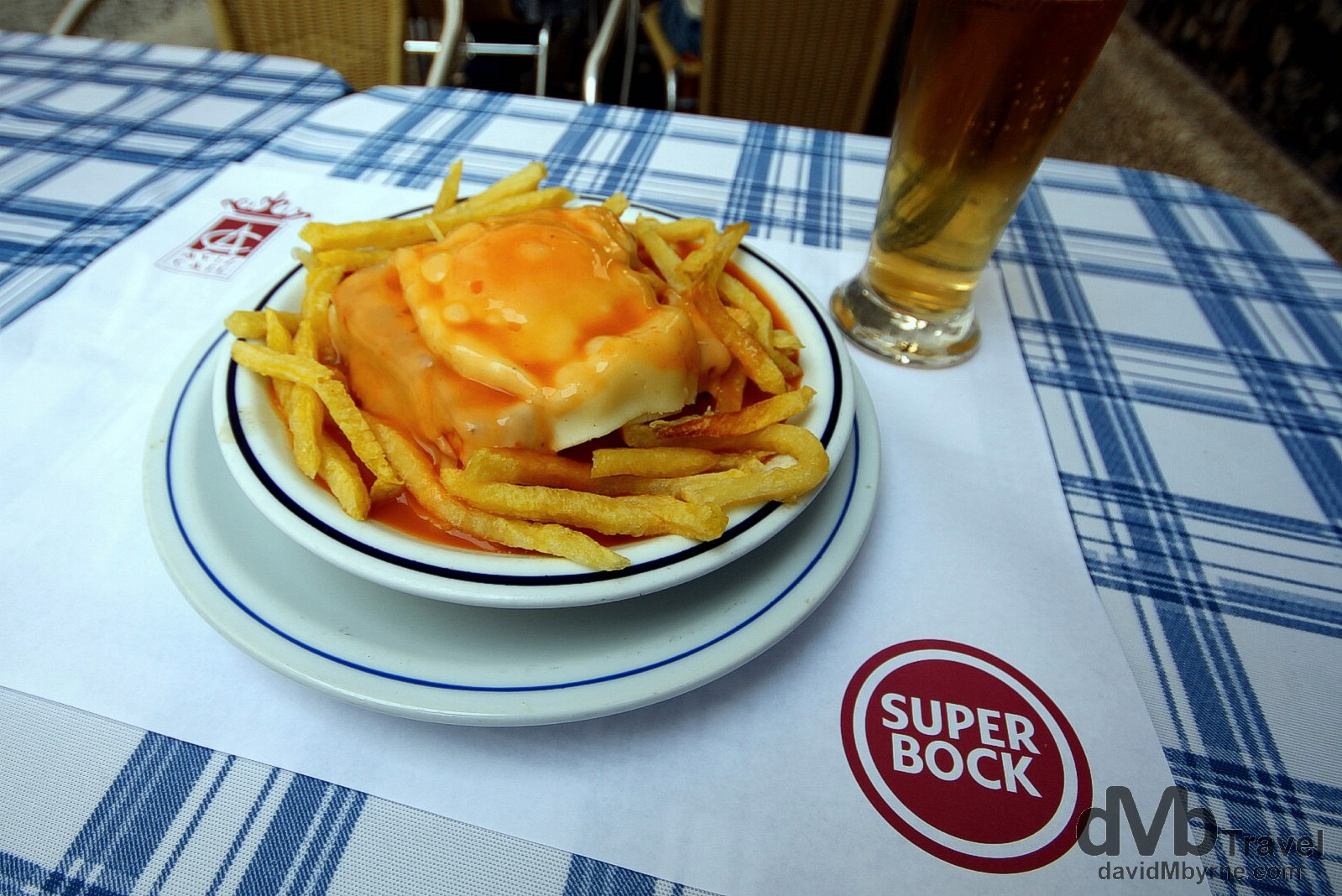 Francesinhas. The Little French Lady, or francesinha as it's known to the locals, is a Porto 'speciality' & by the looks of it a heart attack waiting to happen. Invented in the 1960s, it's a popular dish in Porto while enjoying cult appeal elsewhere. It's a sandwich, a stacked, messy one eaten with a knife & fork. There is no standard recipe (seemingly anything goes) and upon dissecting my AVIZ Café francesinha I found ham, egg, sausage, cheese & olive-infused luncheon meat, all covered in a red tomoto & beer-based sauce. Served with fries and washed down with a Super Bock is quintessential Porto. AVIZ Café, Porto, Portugal. August 28th 2013.