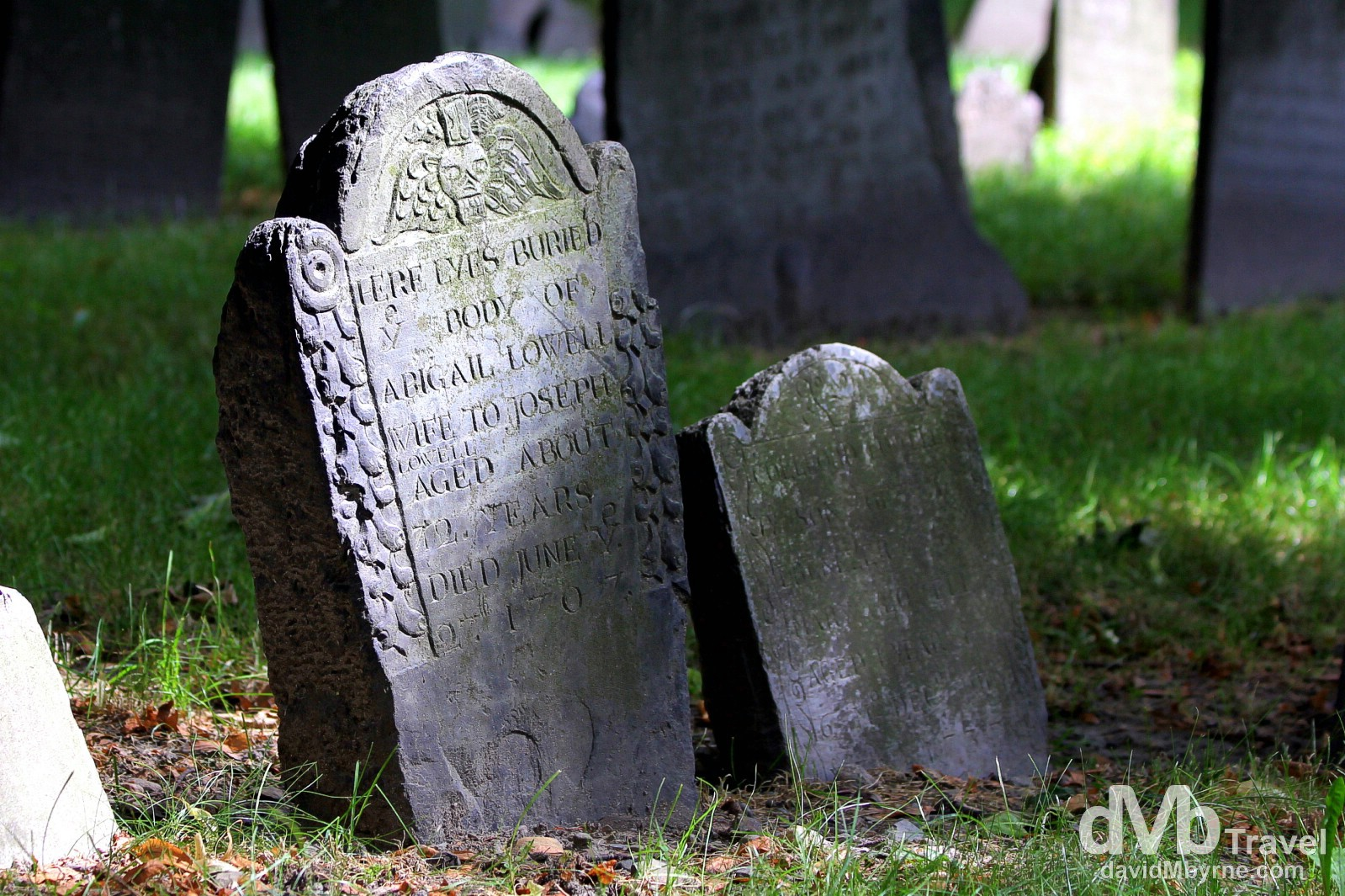 Gravestones in Granary Burying Ground, Tremont Street, Boston. So named because of its proximity to Boston's first granary, the 1660, 2-acre cemetery is one of the oldest historic sites in the city, yet 'only' the third oldest burying ground in Boston - this place is ye olde indeed. It contains 2,345 gravestones and 204 tombs and is the final resting place for may a prominent Bostonian & revolutionary, including John Hancock & Samuel Adams, signers of the American Declaration of Independence. Granary Burying Ground, Tremont Street, Boston, Massachusetts, USA. July 15th 2013.