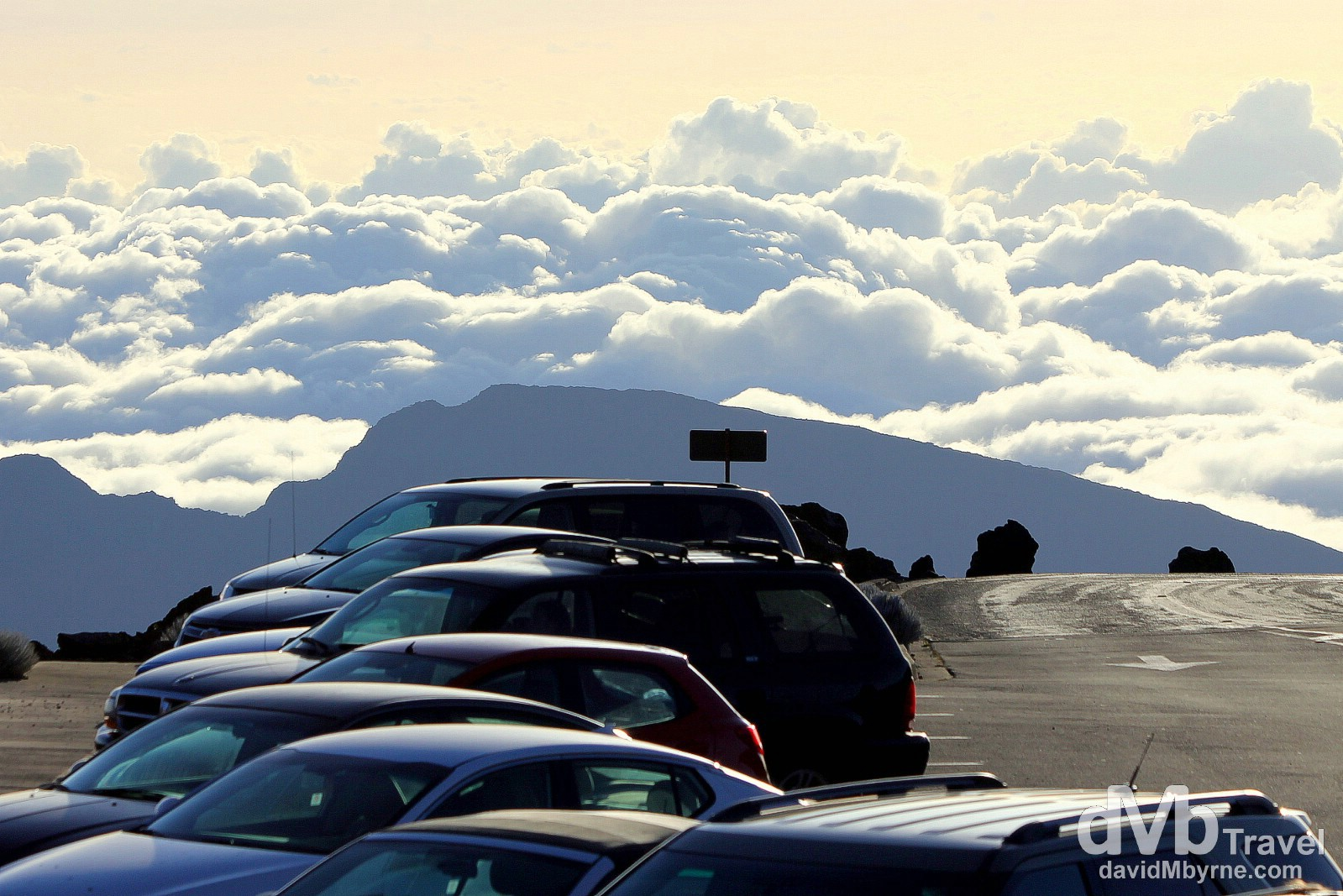 Haleakala is the 10,023 ft-high dormant volcano that dominates the east of Maui, accounting for the bulk of Maui's landmass. Driving up here for sunrise is one of the must-do activities for any visitor - the drive itself holds the world record for the highest elevation gain, 10,000ft+, in the shortage distance driven, 36m/58km. This picture, of cars parked at the summit, was taken shortly after sunrise. Haleakala Crater, Maui, Hawaii, USA. March 6th 2013.