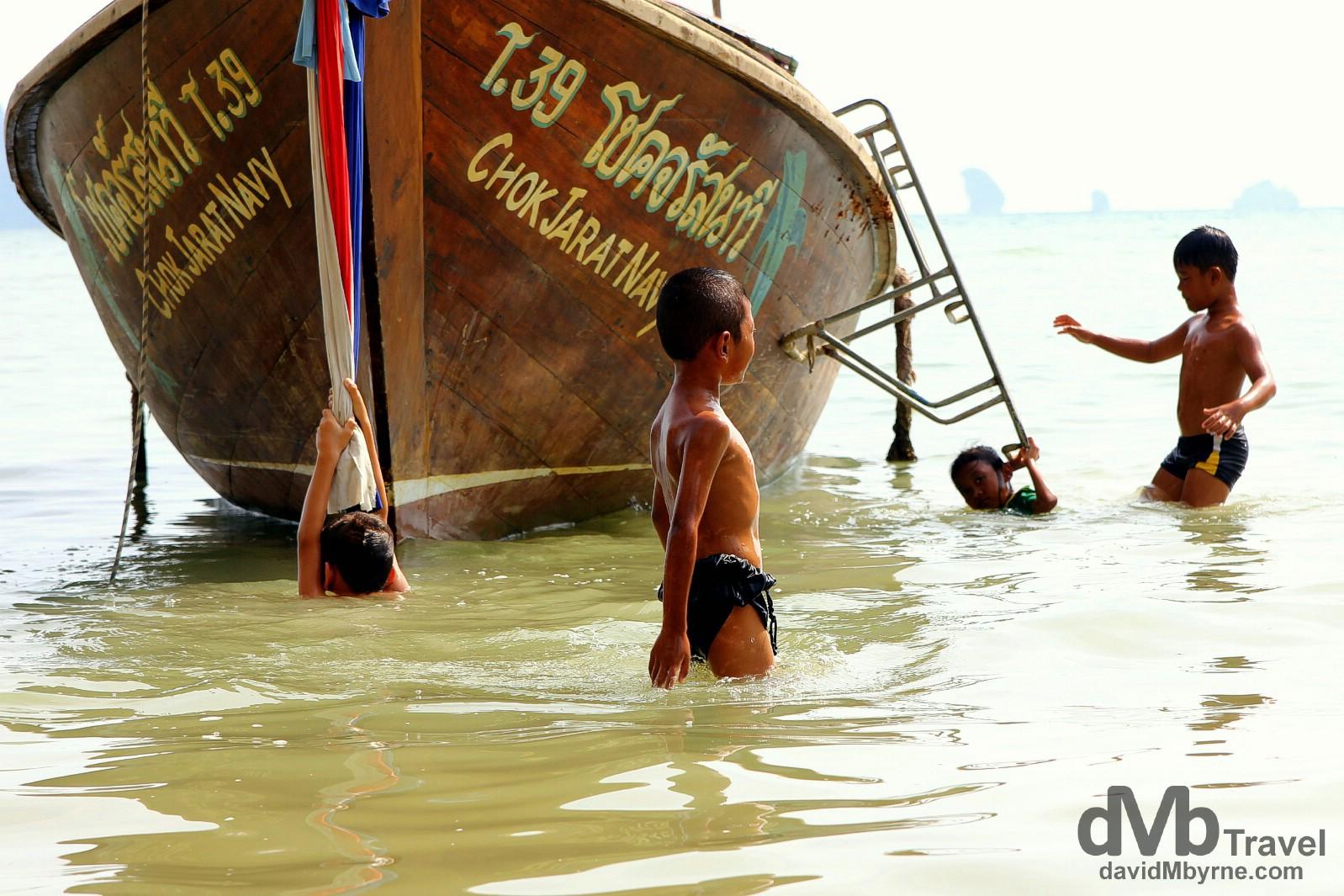 Kids Frolicking in the water off Hat Ton Sai Beach, Krabi, Thailand. March 18th 2012