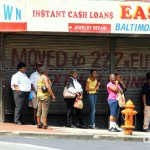 Hanging out on a corner of Howard Street, Westside, Baltimore, Maryland, USA. July 10th 2013.