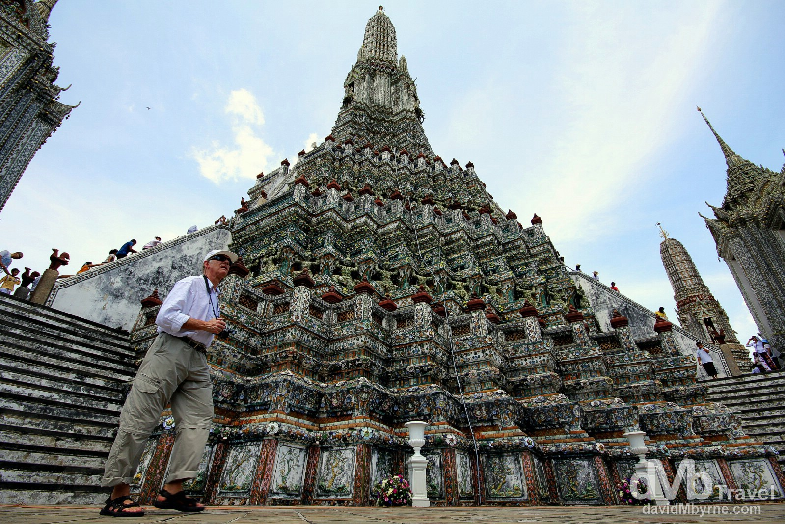 A wide-angle shot of the massive central prang (stupa) of Wat Arun, Bangkok, Thailand. March 7th 2012. This was one of those moments when I was glad I had a wide-angle lens with me; if I didn't I probably wouldn't have even bothered to try photograph this, the massive central stupa of Wat Arun. The stupa is a massive, multi-tiered, wedding cake-esque tower decorated by - rather bizarrely - seashells & pieces of porcelain. The central stupa is surrounded by 4 smaller stupas, two of which appear here to be - thanks to the wide-angle - almost falling in on the central tower. It's a mighty impressive sight & this image really doesn't do it justice.