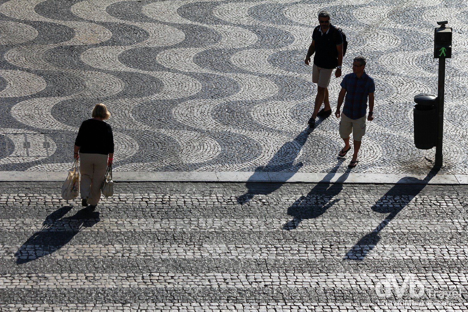 Early morning shadows crossing Praça de D. Pedro IV (Rossio Square), Lisbon, Portugal. August 25th 2013.
