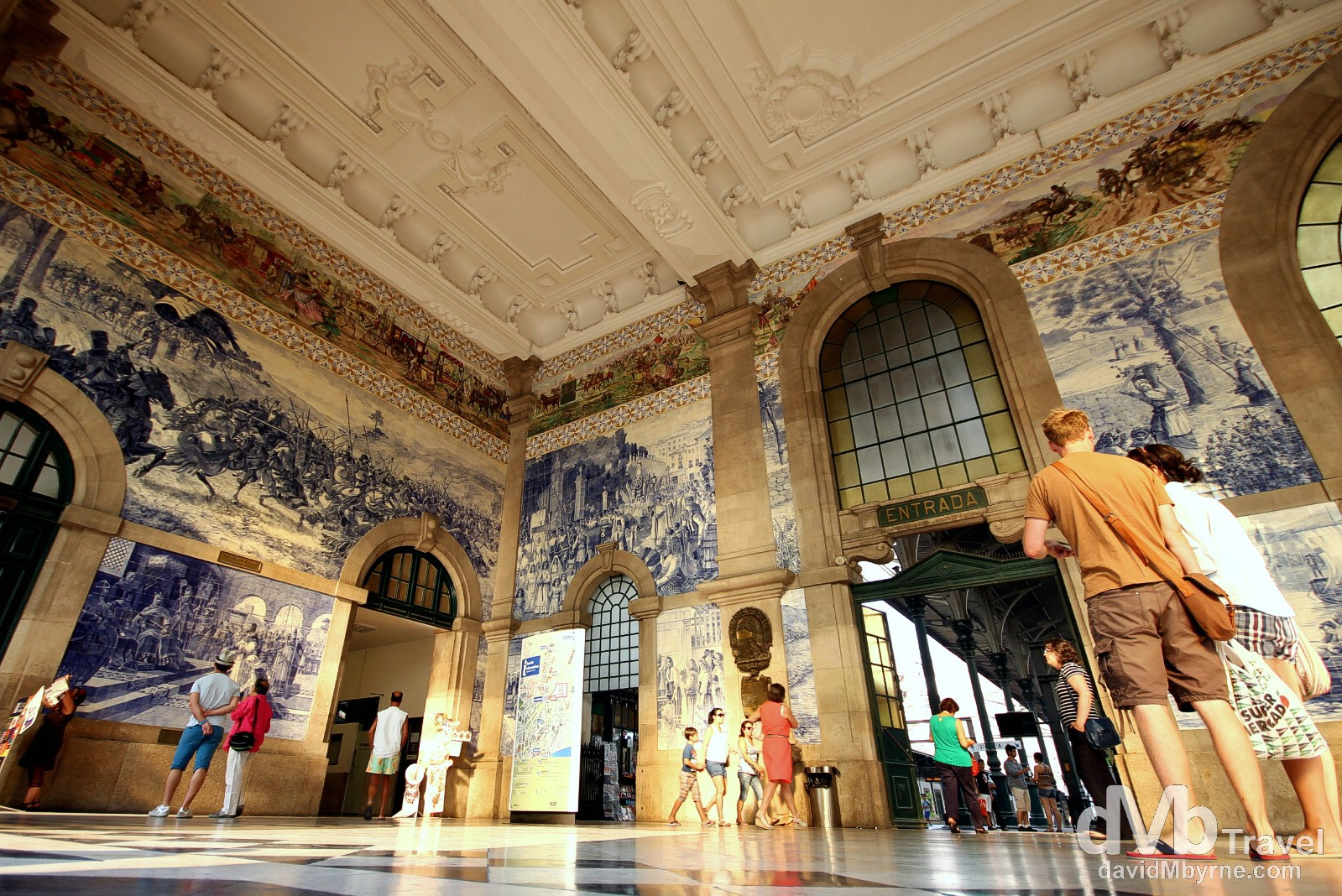 Azulejo in Sao Bento Station. Azulejo is a form of Portuguese painted ceramic tile work that has been produced without interruption for five centuries & has become a typical aspect of Portuguese culture & a major aspect of Portuguese architecture - the tiles are applied on walls, floors, ceilings & even on the streets. Ten years of work went into finishing the 20,000 tiles found here, in the vestibule of the 1916 Sao Bento train station, a tourist favourite in the city. The azulejo panels here were painted between 1905-1916 by Jorge Colaco, the most important azulejo painter of the time, & depict landscapes & important historical scenes in Portuguese history. I visited this station numerous times while in the city (it's somewhere you always seem to pass by) but, and while nurturing a fast depleting camera battery, waited until the nice light of sunset cast a warm glow in the vestibule before photographing it. Porto, Portugal. August 28th 2013.