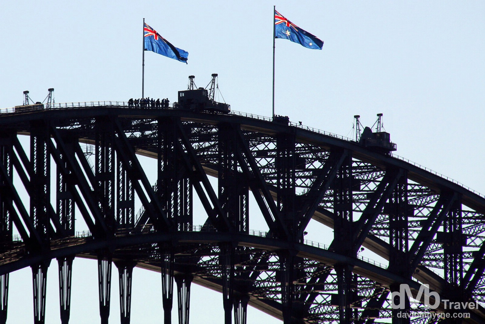 Climbers atop the Sydney Harbour Bridge as seen from the Manly Ferry in Sydney Cove, Sydney, Australia. June 8th 2012.