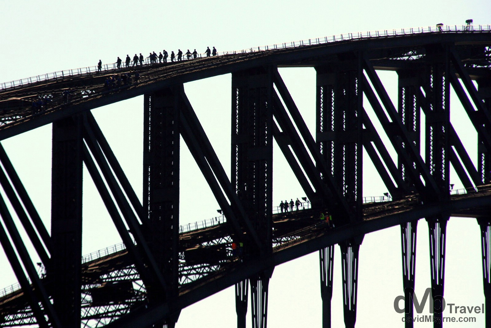 Climbers on the Sydney Harbour Bridge as seen from the Manly Ferry in Sydney Cove, Sydney, Australia. June 8th 2012.