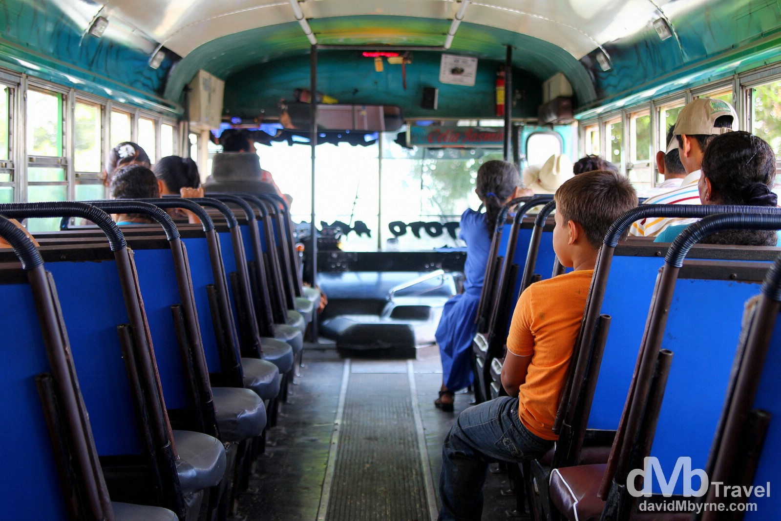 On the unusually quiet chicken bus from Suchitoto to Las Aguilares, El Salvador. This was the first of today's buses. It didn't get much busier than this which, for me, was very unusual. I sat down the back taking pictures. I was in heaven. June 5th 2013.