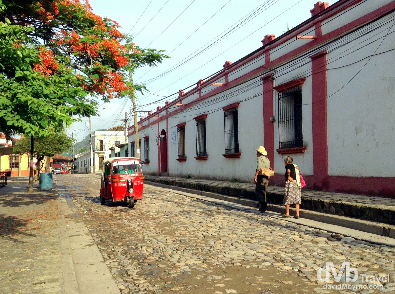 A tuk-tuk & early morning strollers (& shadows) on the cobbled streets of Copan Ruinas, western Honduras. June 8th 2013. (iPod)