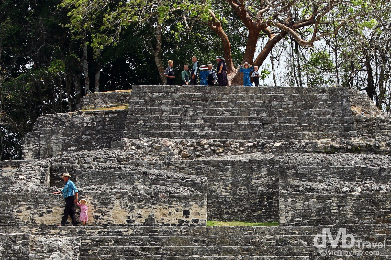 A Mennonite family on the Jaguar Temple at the Lamanai Mayan ruins in Central Belize. May 11th 2013.