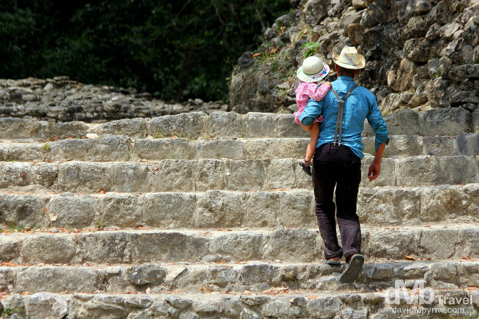 Ascending the steps of the Jaguar Temple at the Lamanai Mayan ruins in Central Belize. May 11th 2013.