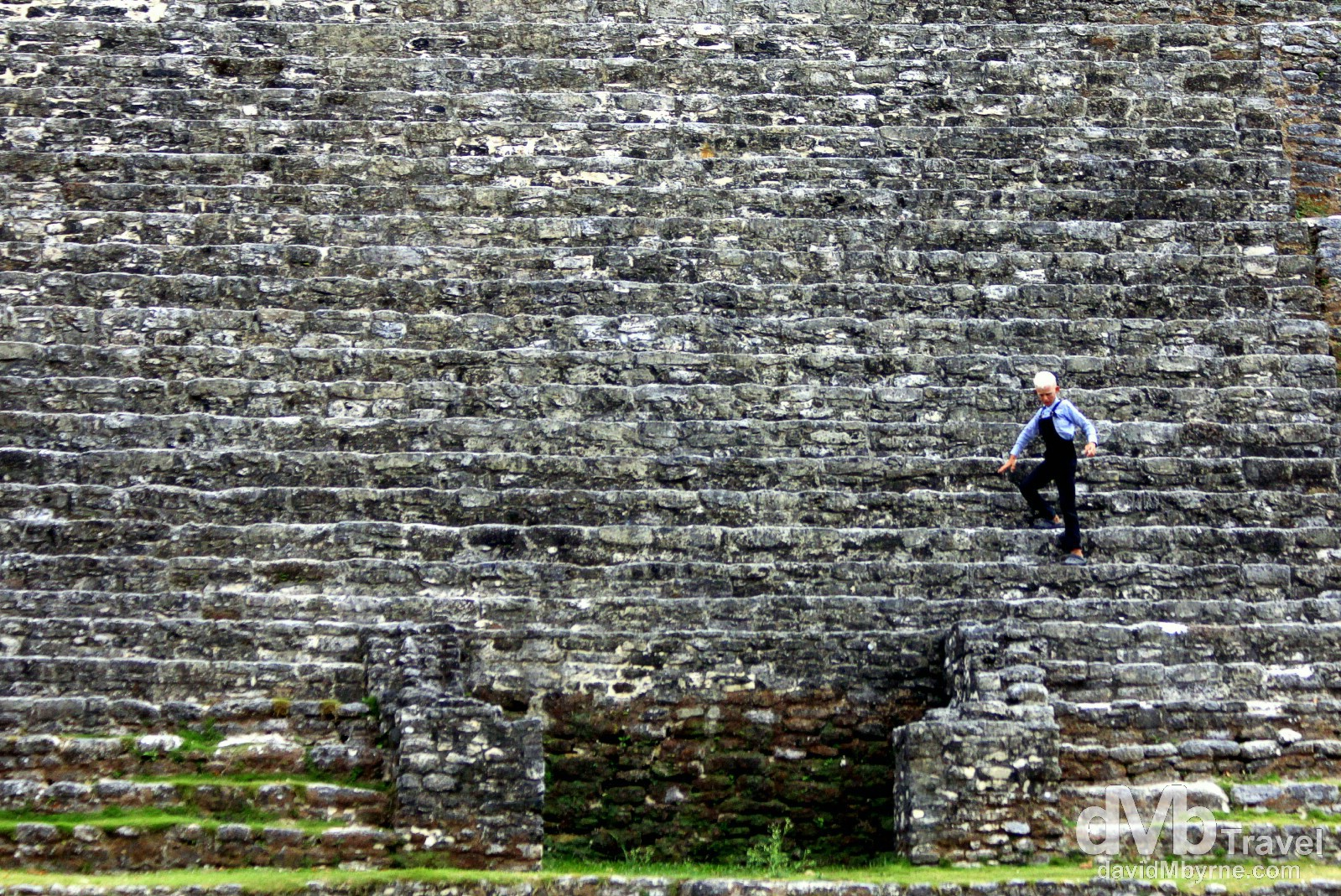 A Mennonite boy descends the steps of the Jaguar Temple at the Lamanai Mayan ruins in Central Belize. May 11th 2013.