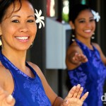 Wahine (women) dancers performing (at 9am) in the open-air terminal of Kona Airport on the Big Island of Hawaii. February 28th 2013.