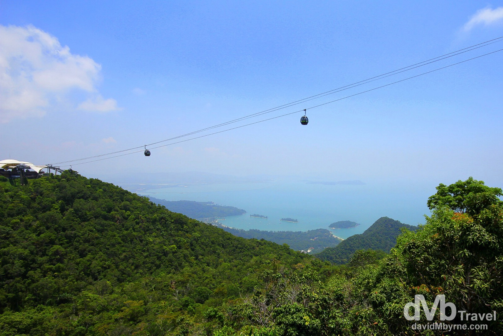 A shot of the west of Langkawi Island from the Top Station of the Langkawi Cable Car. The Cable Car, which opened in 2003, is 2.2km long, spans a section of the island's Machincang mountain range & has 3 stations: Base, Middle (seen to the left, 650m above sea level) & Top (708m above sea level), above which is a viewing platform from where I took this picture. The visibility on this day was very poor - I had to crank the saturation in this & the next picture to show any kind of detail of the surrounding jungle-clad landscape & distant seascape. Gunung Machinchang, Langkawi Island, Malaysia. March 22nd 2012.