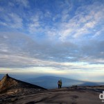 Climbers admiring the poet sunrise view over Sabah, Malaysian Borneo, from the granite expanse leading to the summit of Mount Kinabalu. June 23rd 2012.