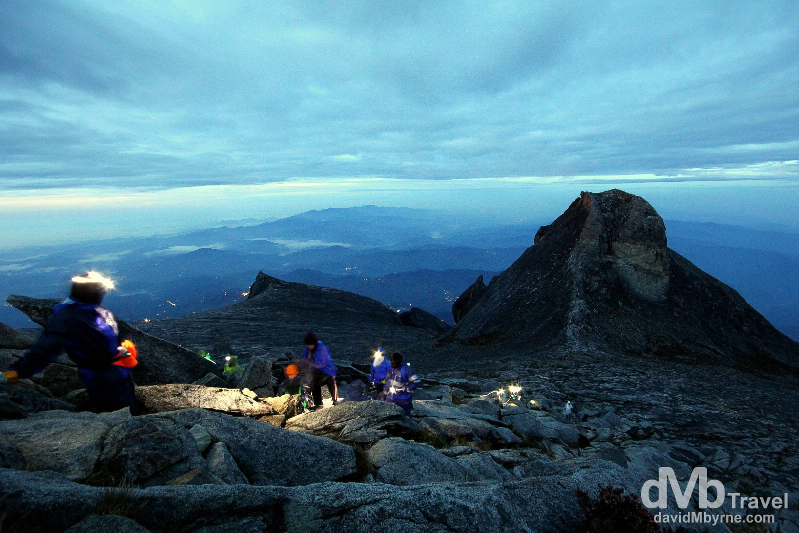 Climbers approaching the 4,095m (13,435ft) summit of Mount Kinabalu, the highest point on Borneo, the world's third largest island. Sabah, Malaysian Borneo. June 23rd 2012