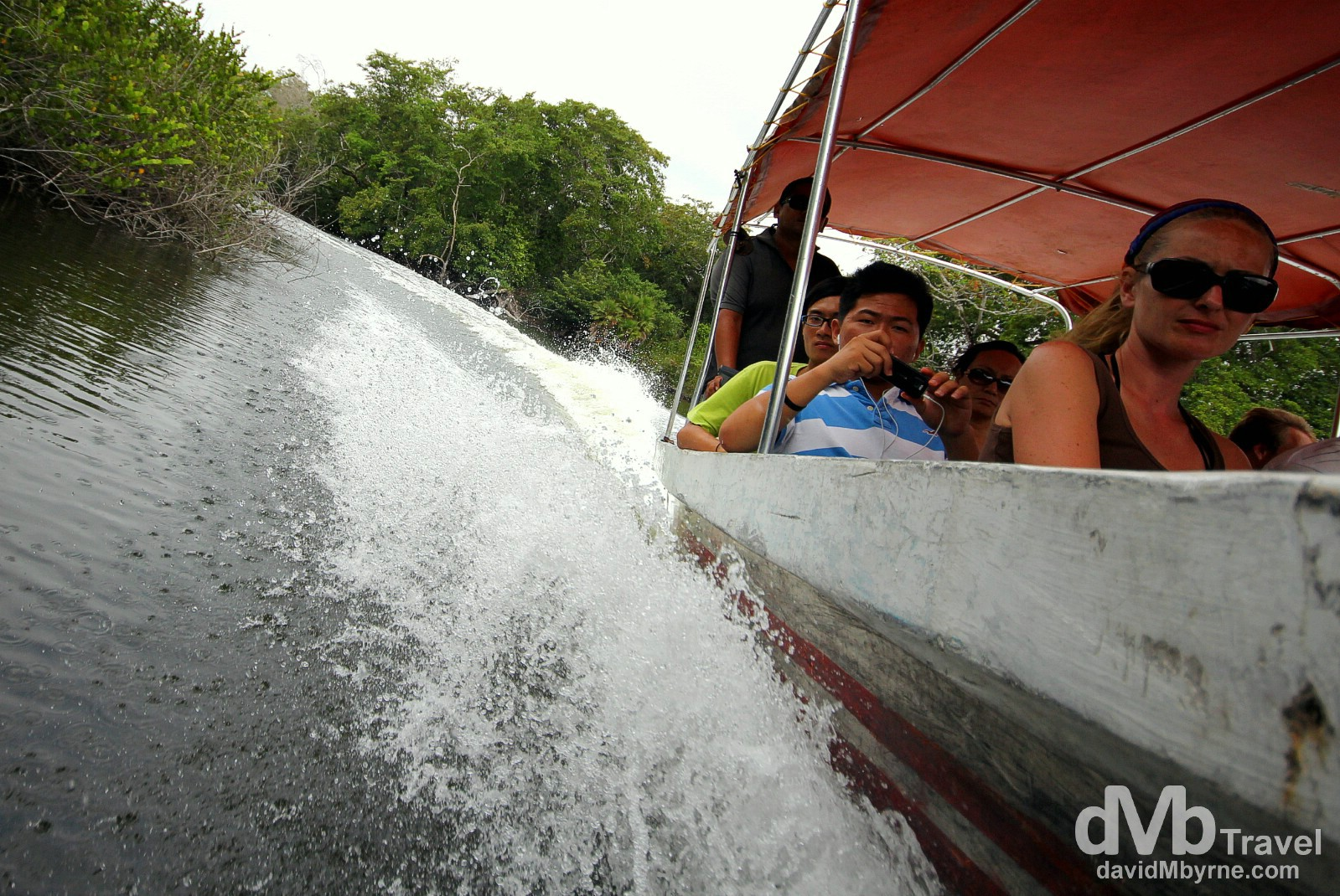 Motor boating on the New River en route from the Lamanai Mayan ruins, Central Belize. May 11th 2013.