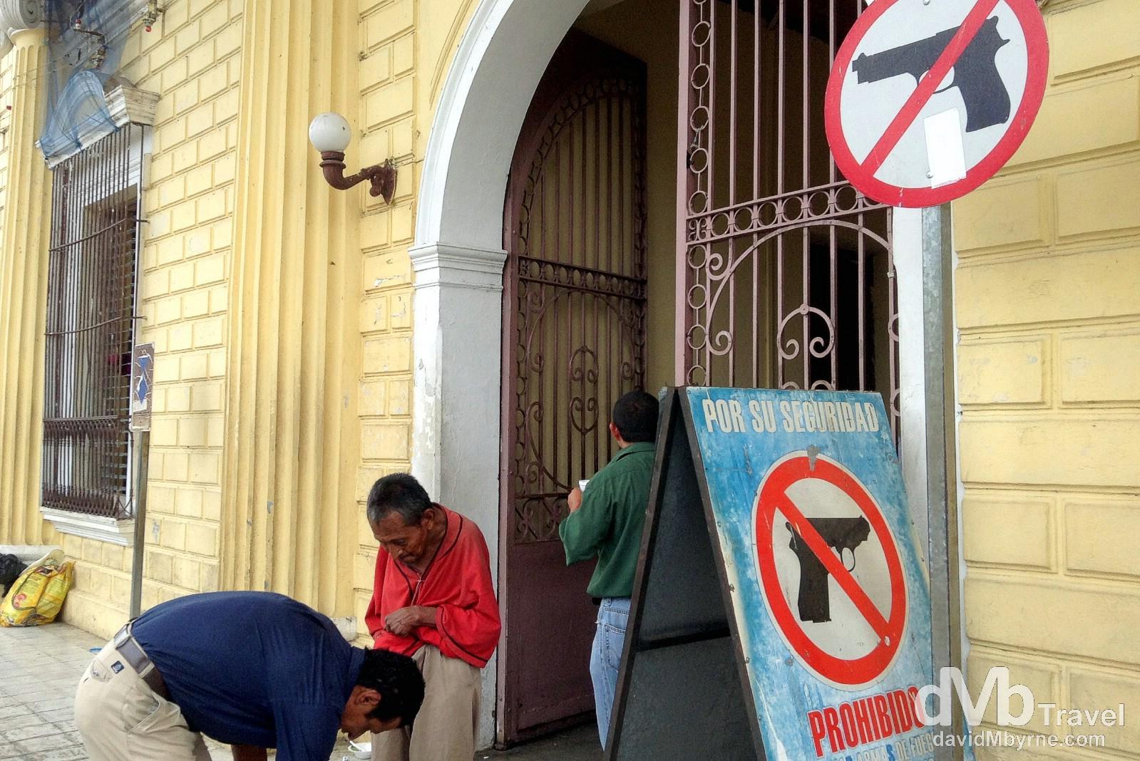 No guns allowed. Outside Santa Ana City Hall, Santa Ana, western El Salvador. May 27th 2013.