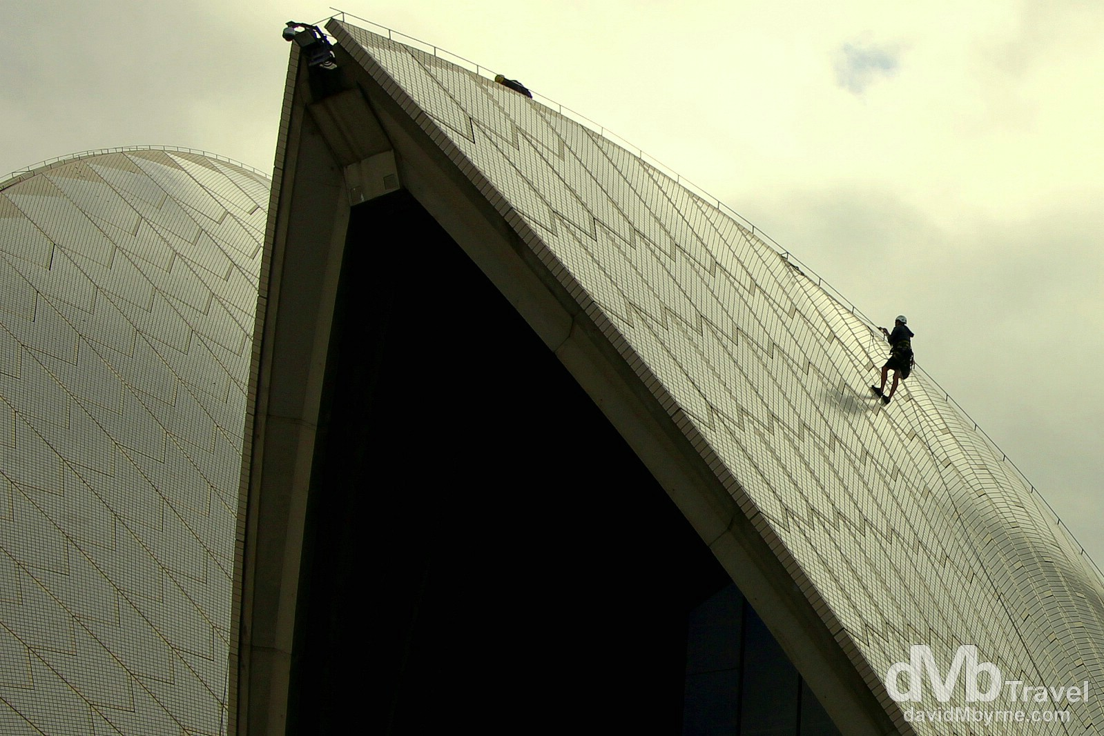 A worker abseiling on the sails of the Opera House in Sydney, Australia. June 5th 2012.