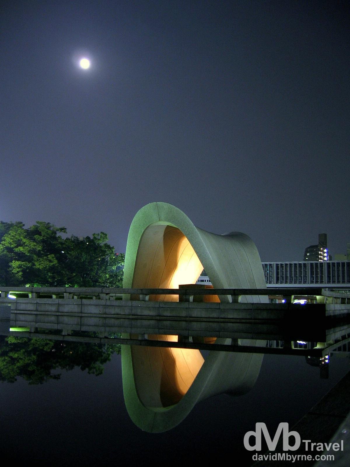Reflections of the Memorial Cenotaph in Hiroshima Peace Memorial Park, Hiroshima, Japan. July 22nd 2005.