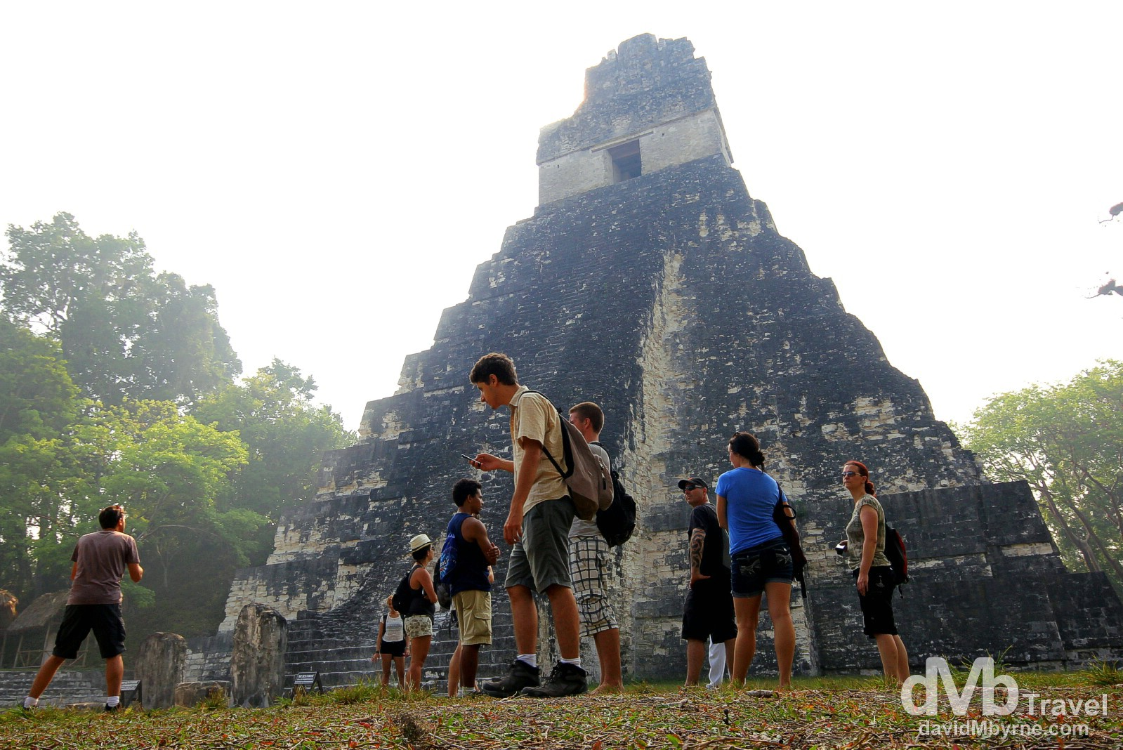 People in front of Temple 1, Temple of the Grand Jaguar in The Gran Plaza, Tikal Mayan ruins, Tikal National Park, northern Guatemala. May 17th 2013.
