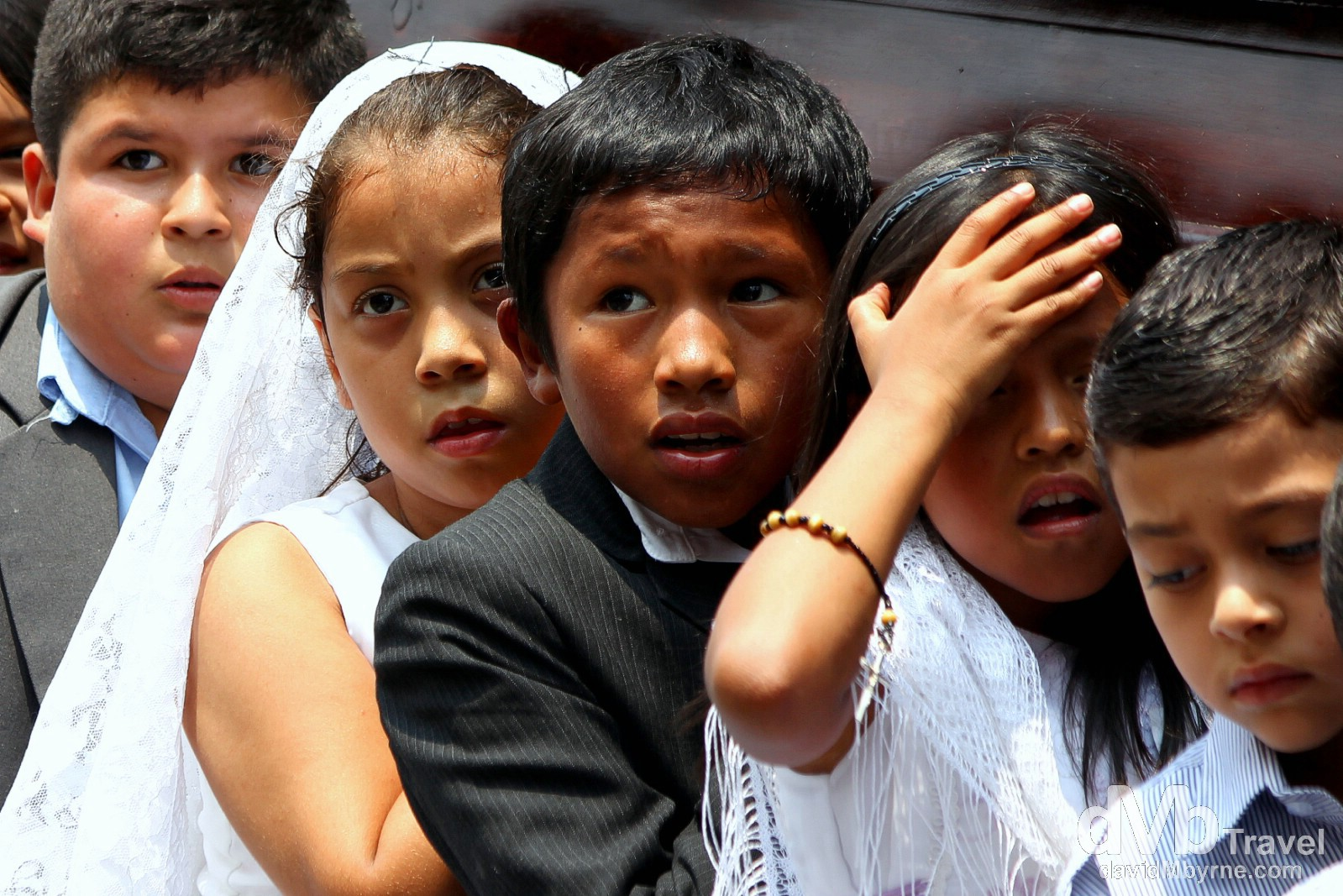 Children carrying a coffin as part of a religious ceremony in Parque Central, Antigua, Guatemala. May 19th 2013.