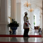 A doorman at the lobby entrance to Raffles Hotel, Singapore. March 28th 2012.