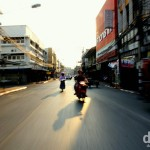 Motion & late afternoon shadows as seen from the back of a moving sawngthaew, a Thai open-backed pick-up that doubles as a taxi, on the way to the Chiang Mai bus station to get the bus to Bangkok. March 15th 2012. on the streets of Chiang Mai, northern Thailand. March 15th 2012