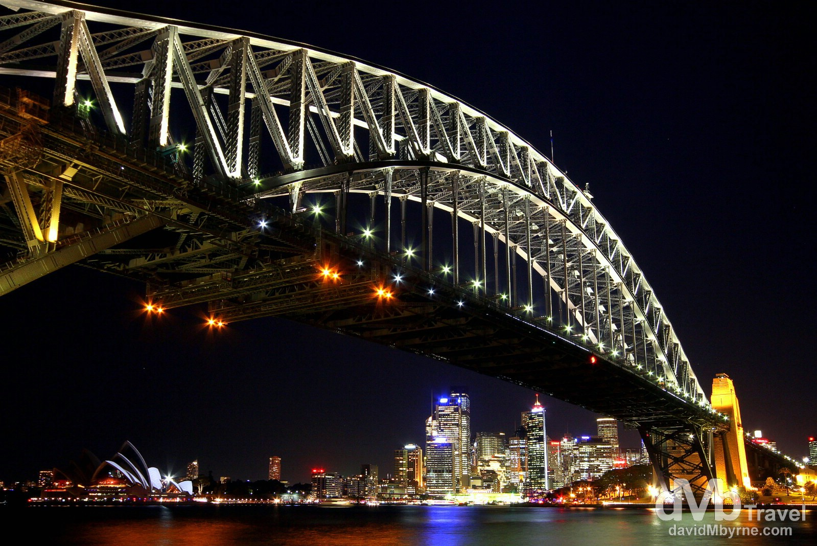 The Sydney CBD as seen at night from under the Harbour Bridge in the Kirribilli district of the city. June 7th 2012.