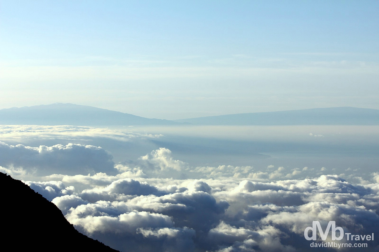 For me the sunrise from Haleakala was secondary to the amazing views, not only of the clouds hovering above Maui (& far below me) but also of the distant peaks of Mauna Kea (one the left) & Mauna Loa (on the right) on the Big Island, 100m/160km & 80m/128km &amp away respectively - it was especially gratifying peering across at Mauna Kea, having stood on its snowy, 13,796ft/4,205m summit a few days earlier. Haleakala National Park, Maui, Hawaii. March 6th 2013.