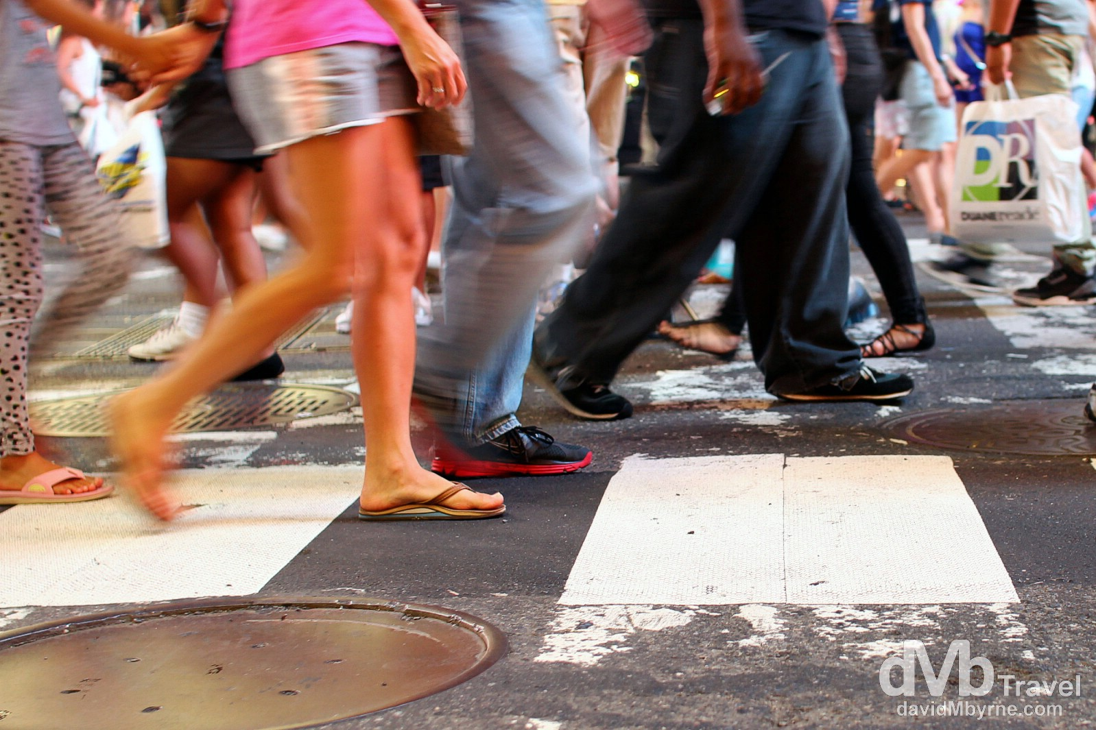 Walkers in a busy Times Square, Manhattan, New York. July 13th 2013.