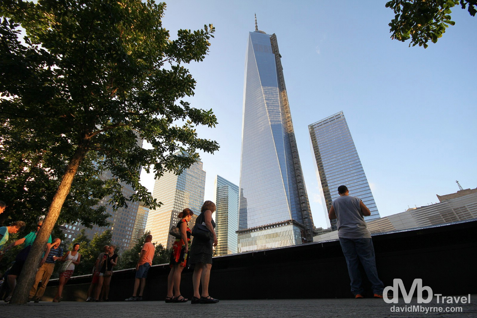Towers of the rebuilt World Trade Center towering over the The 9/11 Memorial, lower Manhattan, New York City, USA. July 14th 2013.