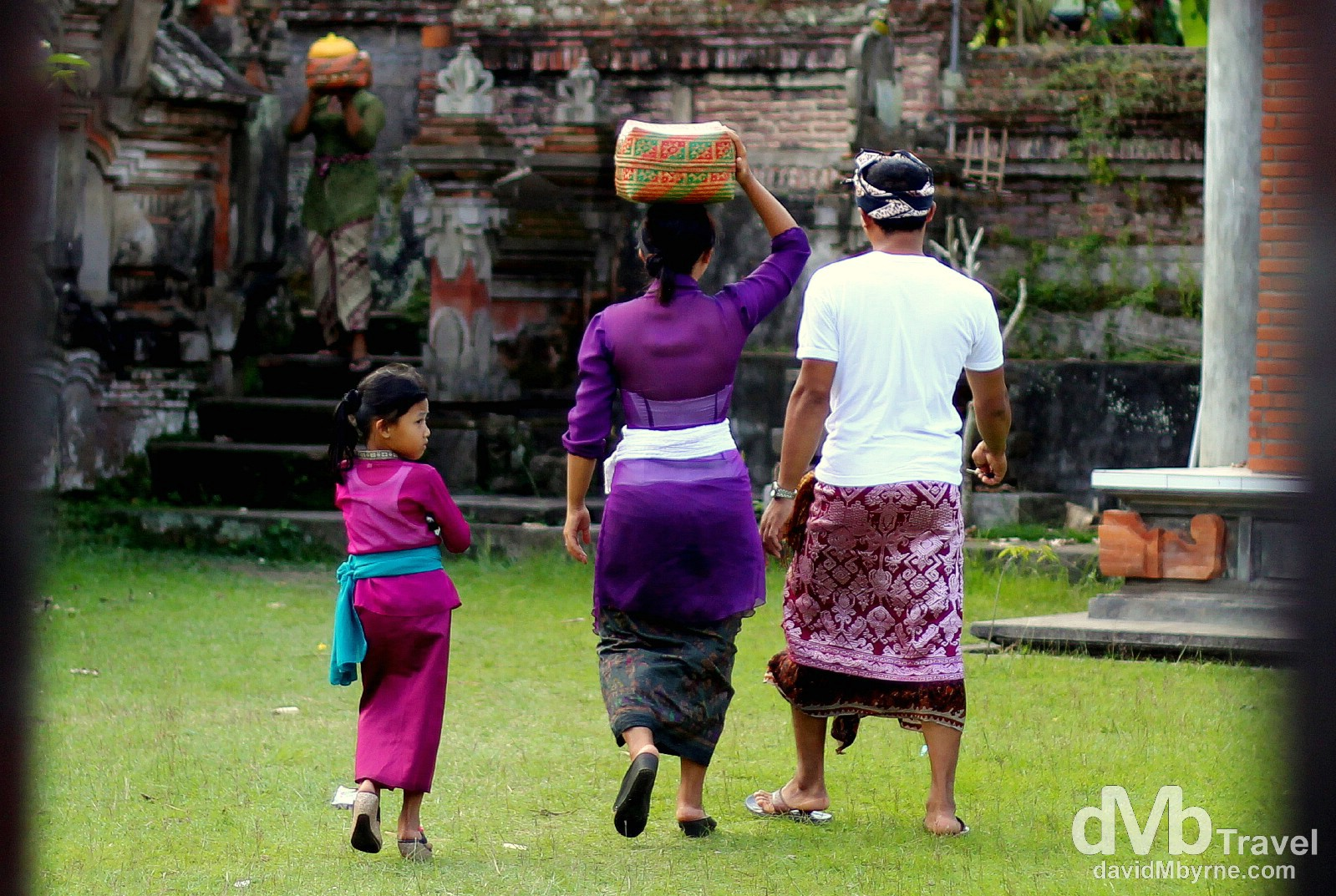 A family in the grounds of banjar (temple), Singakerta, Ubud, Bali, Indonesia. June 16th 2012.