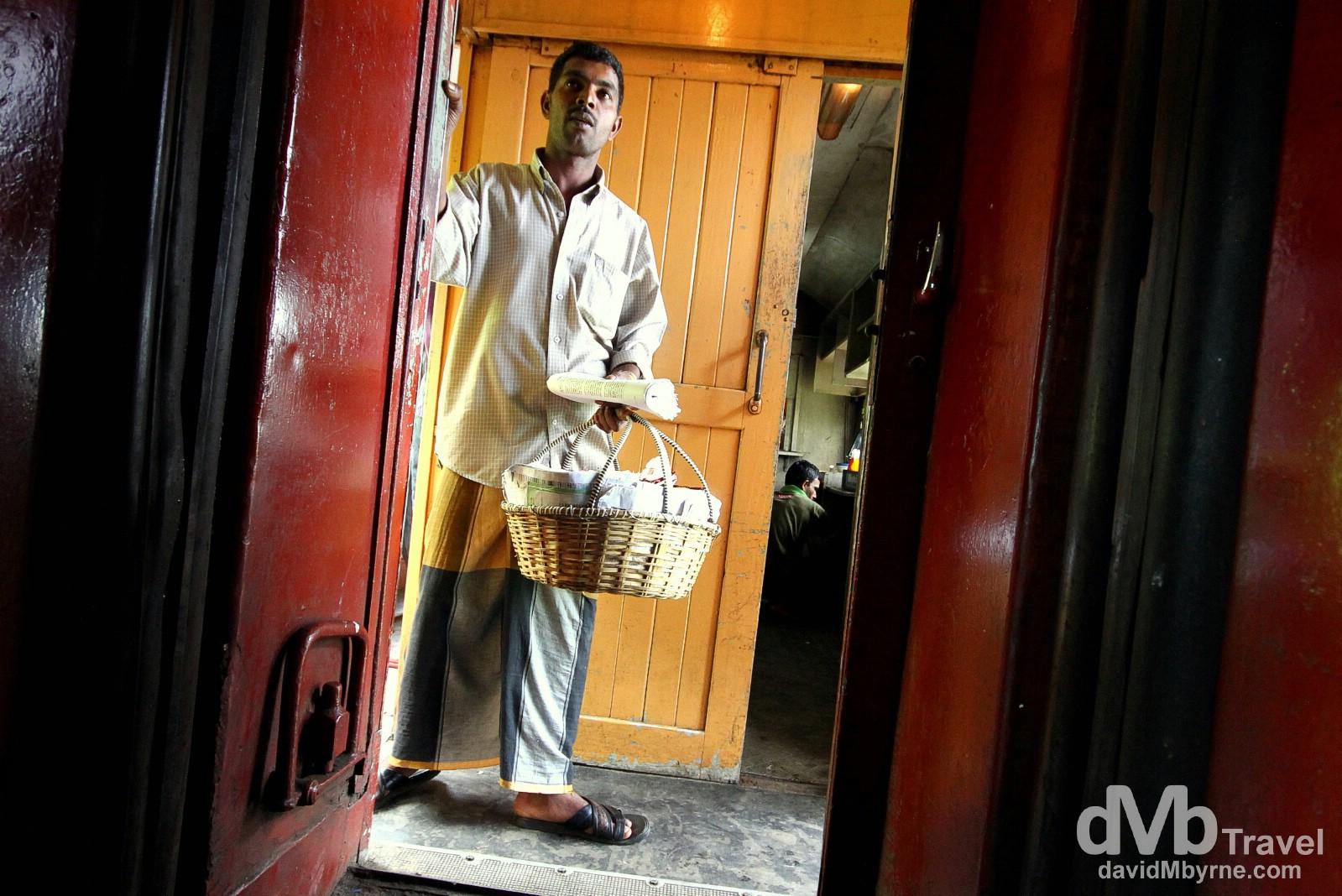 A vendor on the Kandy-bound train, central Sri Lanka. September 7th 2012.