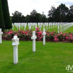 The American War Cemetery in Normandy, France, recognisable from the opening scenes of the 1998 WWII movie 'Saving Private Ryan', overlooks Omaha beach, the D-Day beach stormed by the Americans and the beach that saw the most intense fighting and accounted for most of the D-Day causalities. This sombre place is the final resting spot for just under 10,000 soldiers who died in the overall battle of Normandy. They are buried under solid white marble crosses in orderly rows set amongst the most impeccably manicured lawns I've ever seen. The site is 720 acres in size, land that was, at the end of the war, given to the Americans by the French government in perpetuity. American War Cemetery, Colleville sur mer, Normandy, France. August 16th 2007.