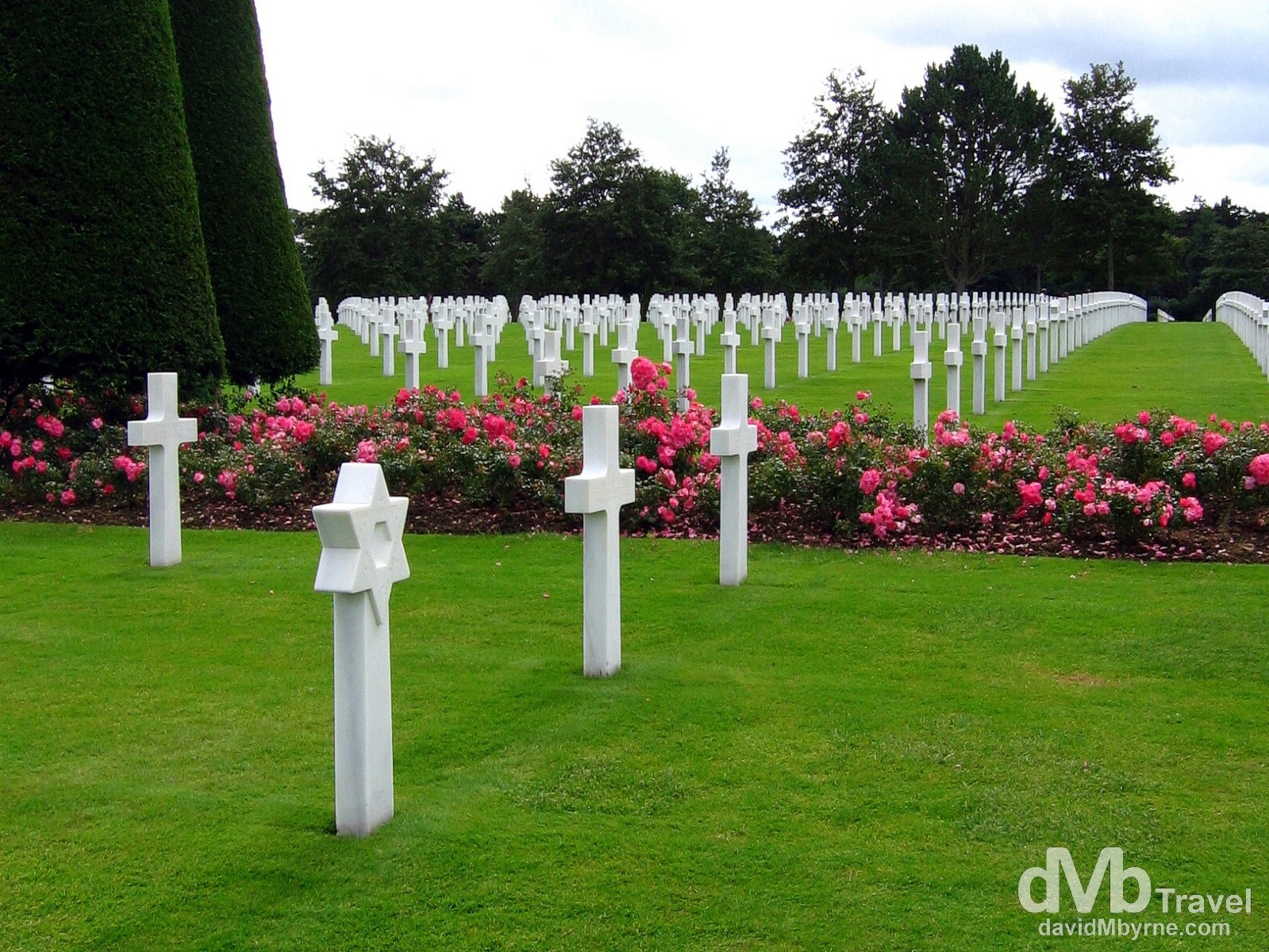 The American War Cemetery in Normandy, France, recognisable from the opening scenes of the 1998 WWII movie 'Saving Private Ryan', overlooks Omaha beach, the D-Day beach stormed by the Americans and the beach that saw the most intense fighting and accounted for most of the D-Day causalities. This sombre place is the final resting spot for just under 10,000 soldiers who died in the overall battle of Normandy. They are buried under solid white marble crosses in orderly rows set among the most impeccably manicured lawns I've ever seen. The site is 720 acres in size, land that was, at the end of the war, given to the Americans by the French government in perpetuity. American War Cemetery, Colleville sur mer, Normandy, France. August 16th 2007.