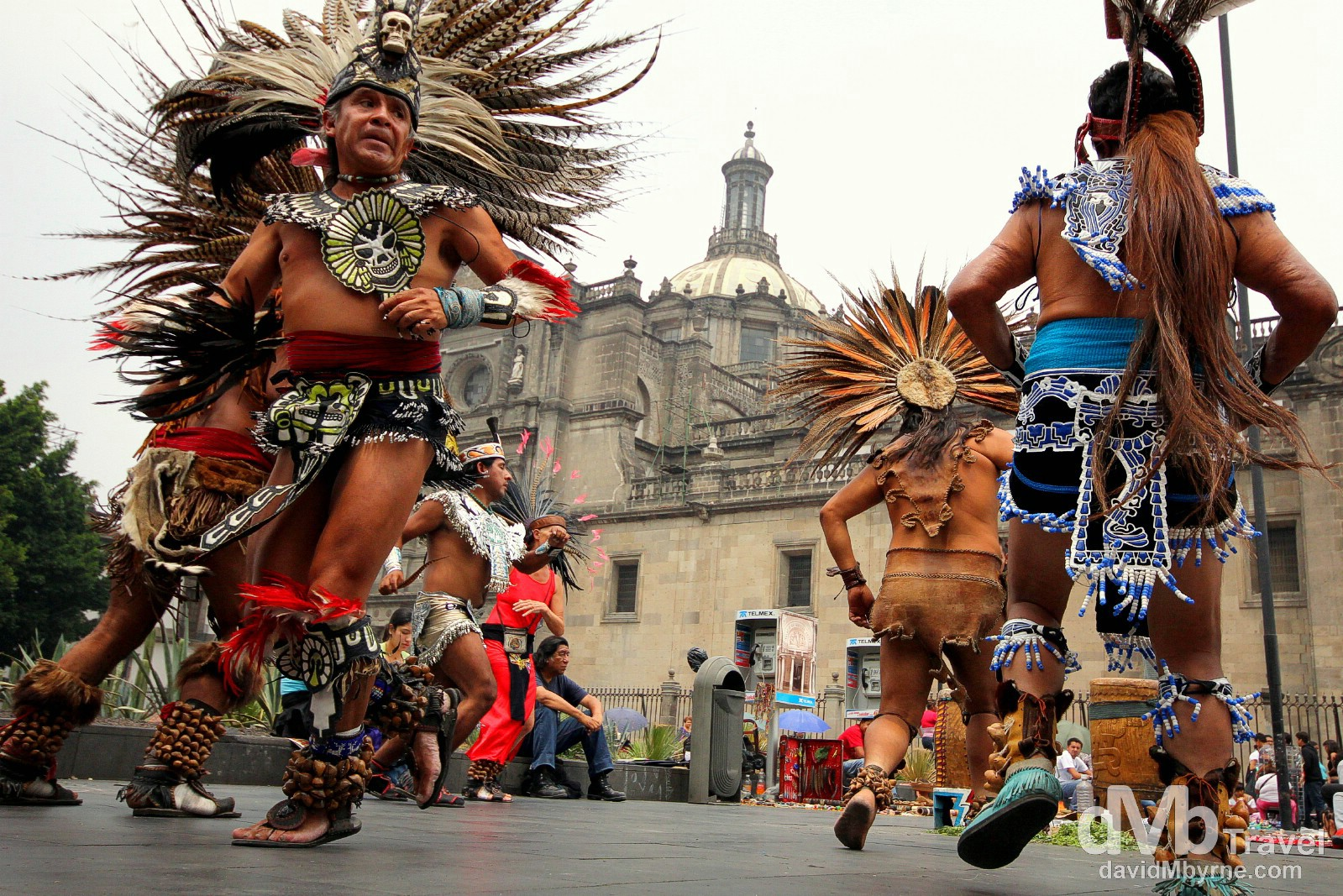 A for-tourists Aztec war dance in the Zocalo, the heart of Mexico City, formally called the Plaza de la Construction, with a section of the Catedral Metropolitana, Mexico City's most iconic structure, in the background. Mexico City. April 26th 2013.