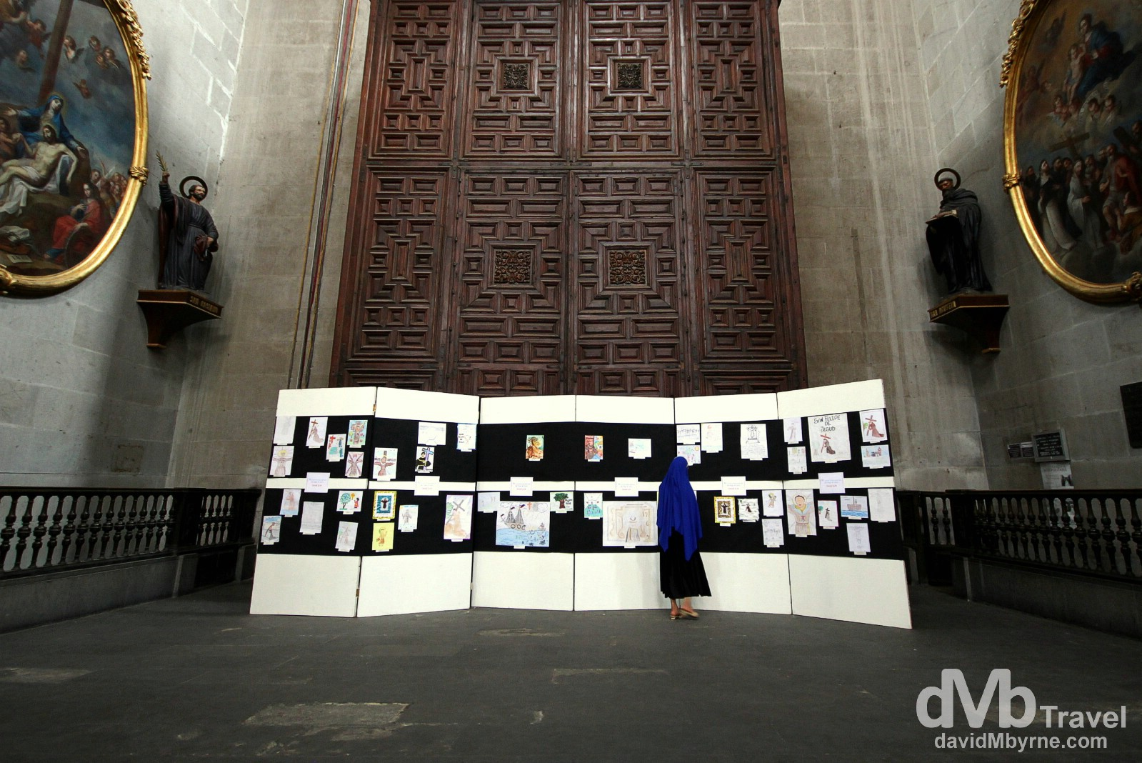 A nun looks at a display in a section of the Catedral Metropolitana, Mexico City. April 26th 2013.