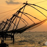 Chinese fishing nets at the tip of Fort Cochin at sunset, Kerala, India. September 19th 2012.