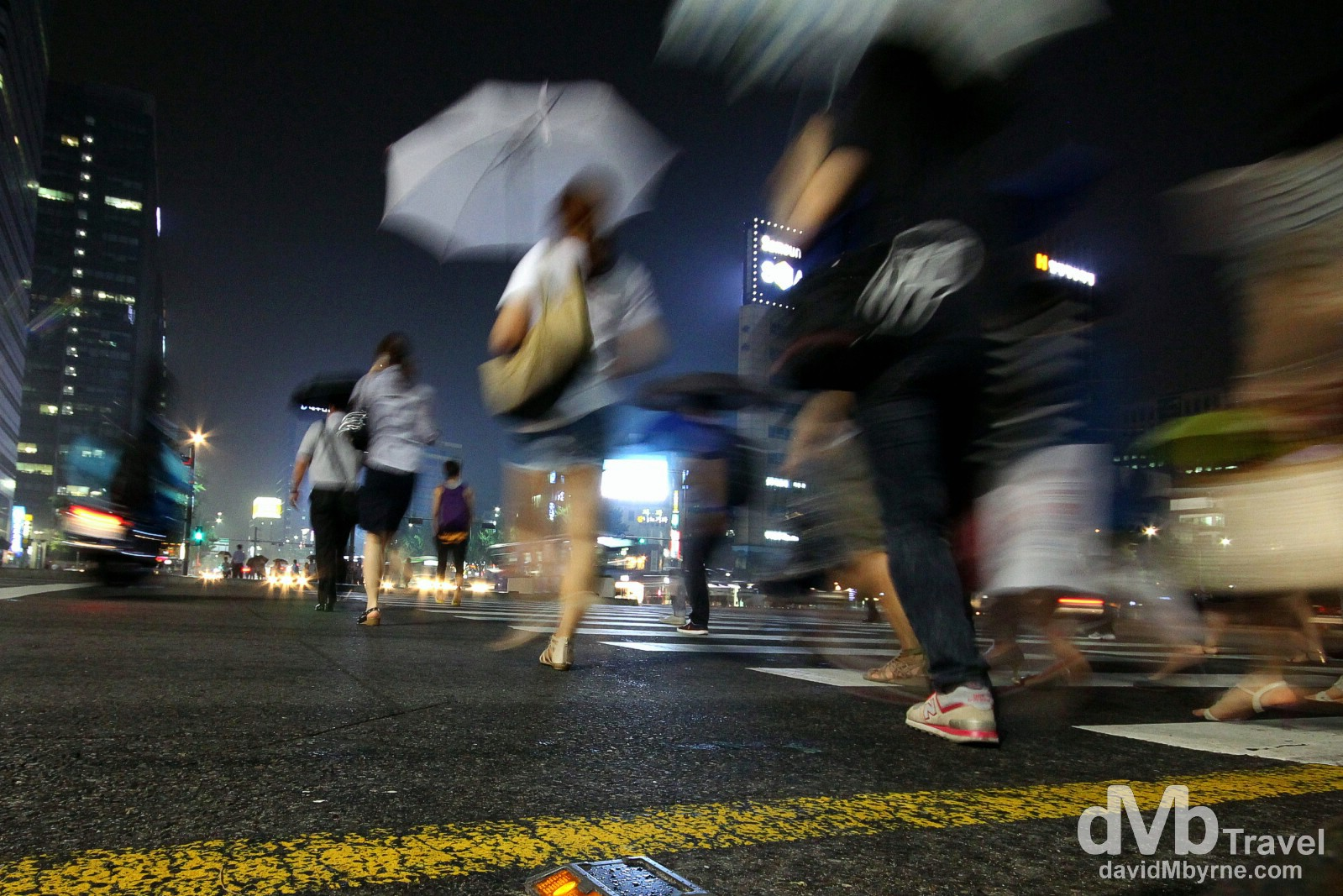 Crossing the road in light rain in Jongno, Seoul, South Korea. July 12th 2012.