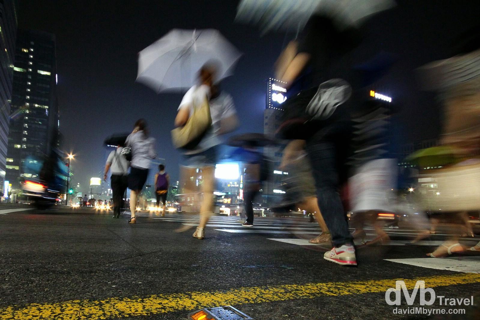 Crossing the road in light rain in Jongno, Seoul, South Korea. July 12th 2012.