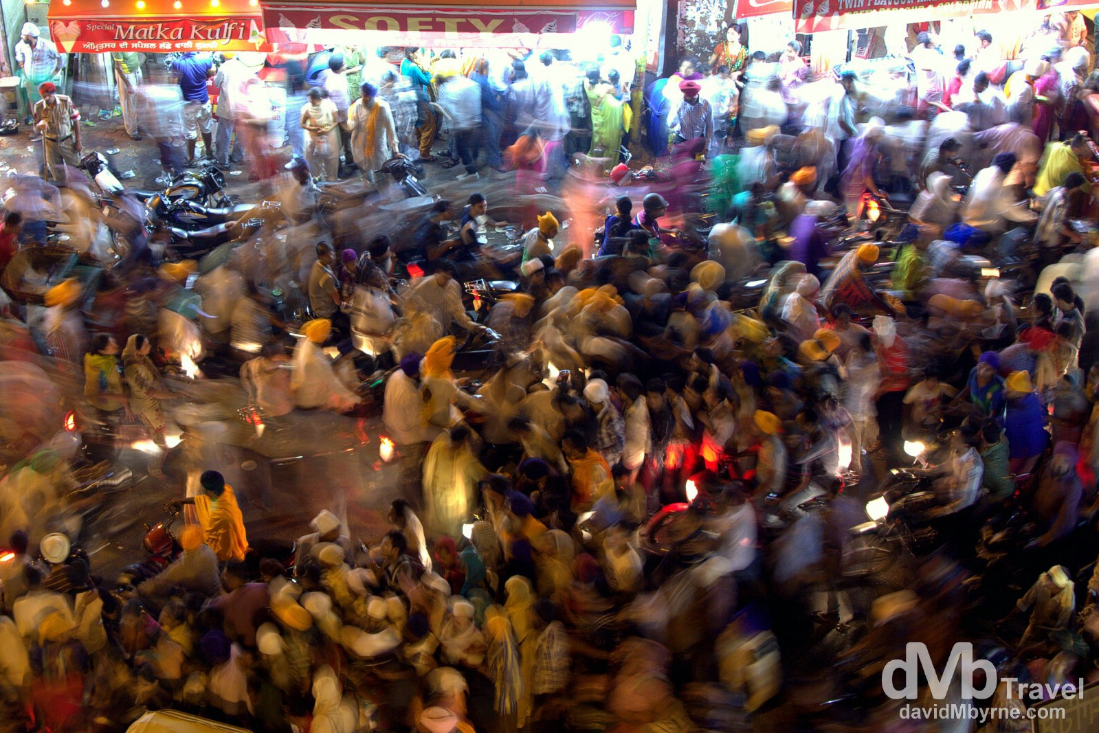 Crowds making their way to & from the Golden Temple along the crammed Old City streets of Amritsar, India. October 9th 2012.