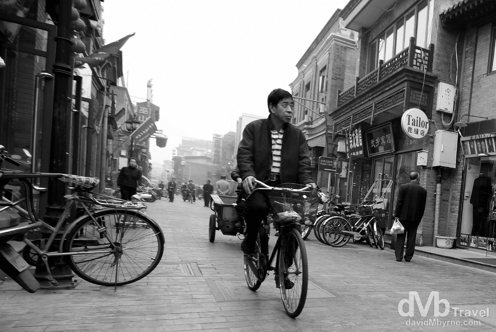 Cycling in the Qianmen district of Beijing, China. October 26th 2012.