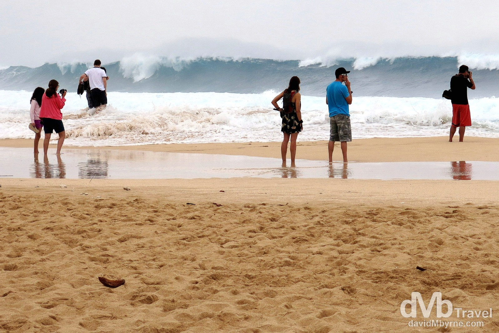 Watching the winter, experienced-surfers-only waves on Ehukai Beach Park, North Shore, Oahu, Hawaii, USA. March 10th 2013.