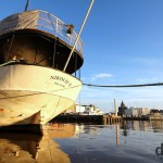 A café boat moored in Eteldsatama beside the morning Kauppatori (Fish Market) in Helsinki, Finland. November 24th 2012.