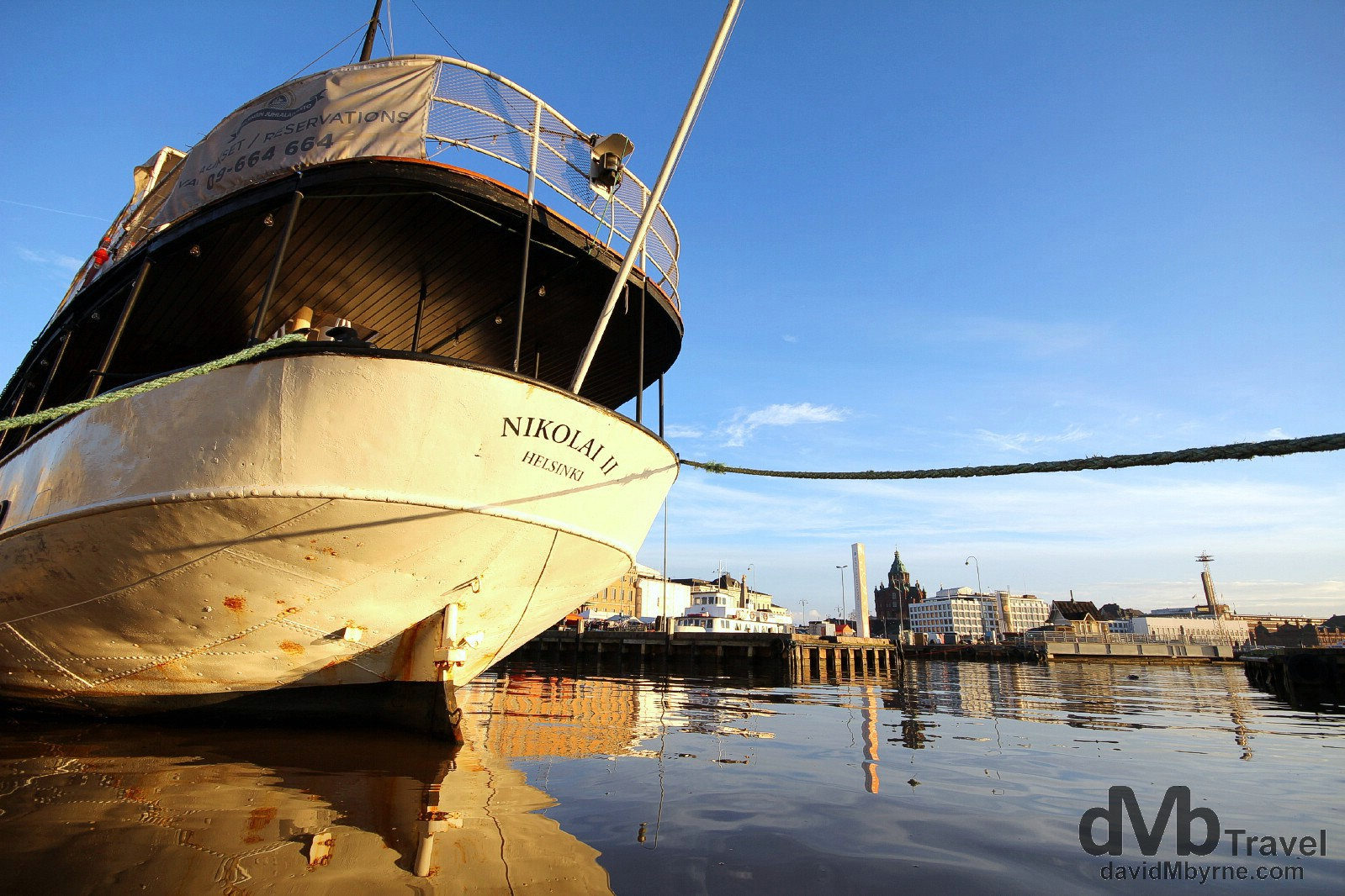 A café boat moored in Eteldsatama beside the morning Kauppatori (Fish Market) in Helsinki, Finland. November 24th 2012.