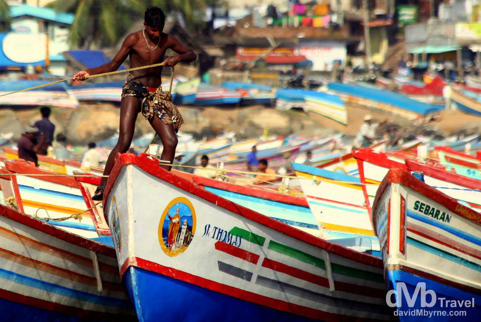 Working with boats in a fishing village outside of Kovalam, Kerala, southwestern India. September 13th 2012.