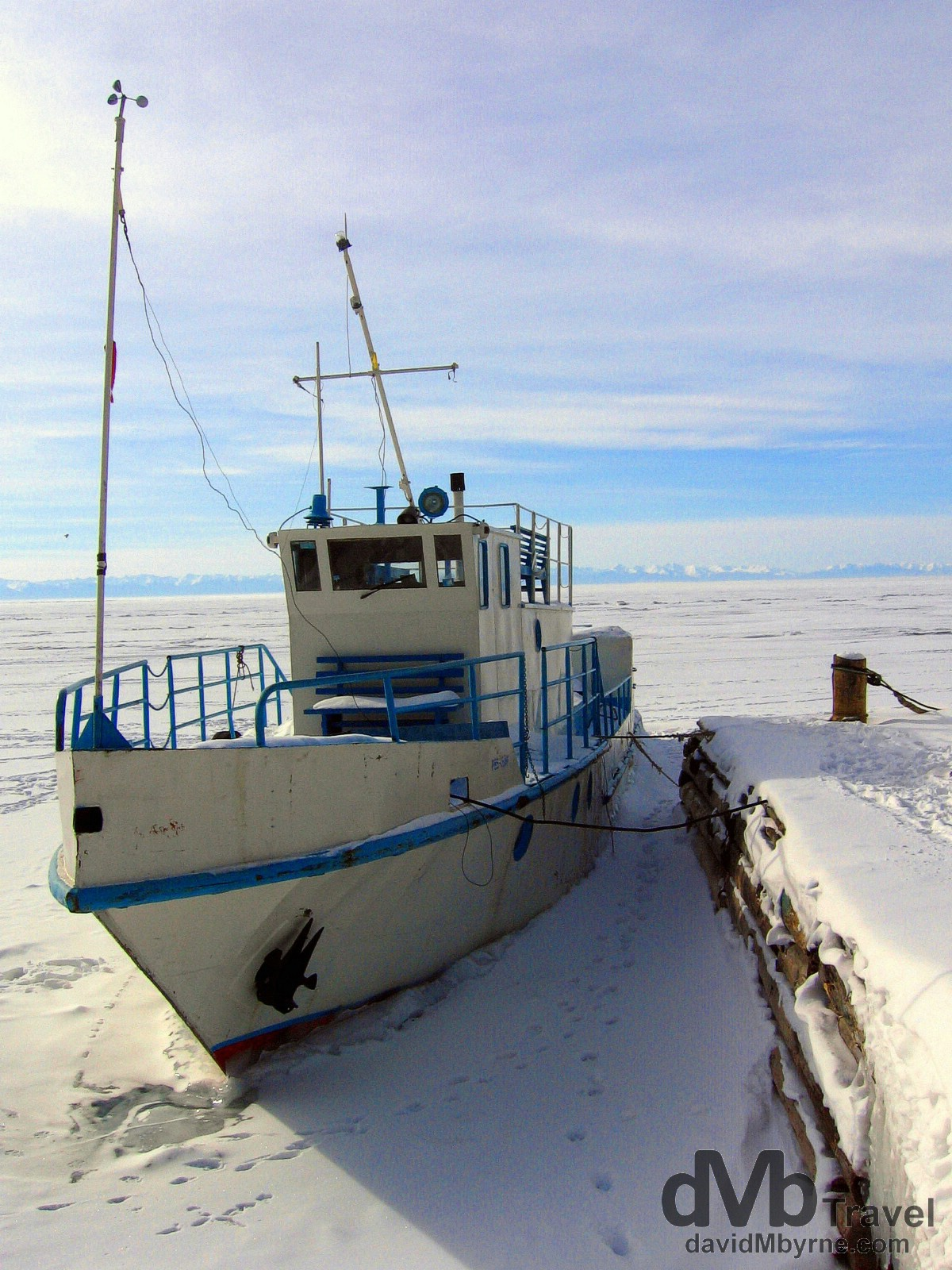 A boat waiting out the winter freeze in the fishing port of Listvyanka on the shores of Lake Baikal. Listvyanka, Siberia, Russia. February 18th, 2006.