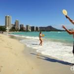 Paddle ball on Waikiki Beach with the Waikiki landmark of Diamond Head in the distance. Oahu, Hawaii, USA. March 9th 2013.