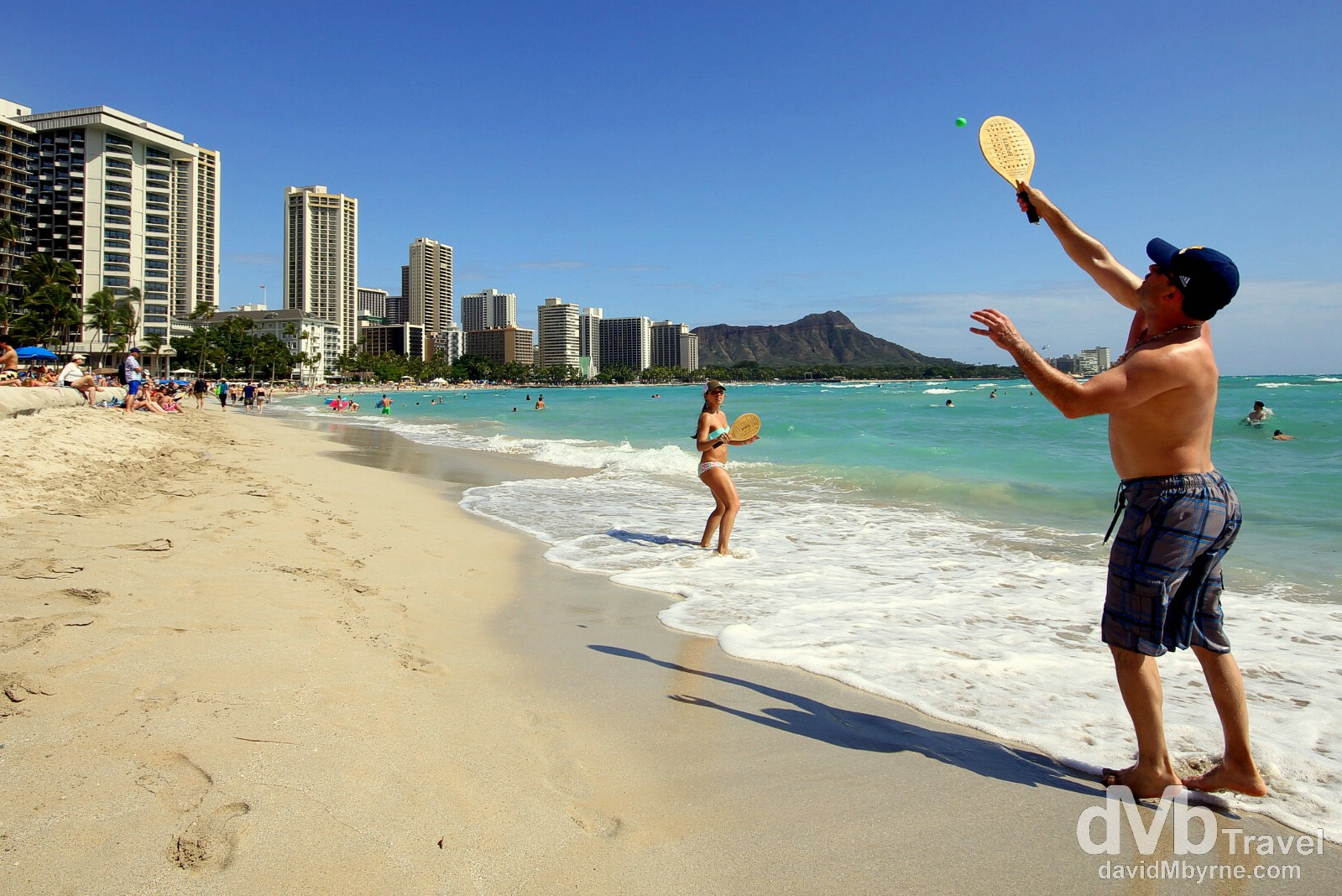 Paddle ball on Waikiki Beach with the Waikiki landmark of Diamond Head in the distance. Oahu, Hawaii, USA. March 9th 2013.